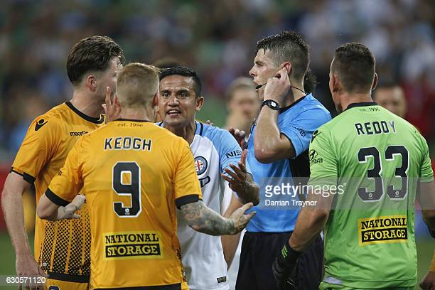 Tim Cahill of Melbourne City argues with Any Keogh of Perth Glory during the round 12 ALeague match between Melbourne City and Perth Glory at AAMI...