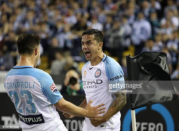 Tim Cahill of Melbourne City celebrates with Bruno Fornaroli after scoring a goal during the round two ALeague match between Melbourne Victory and...