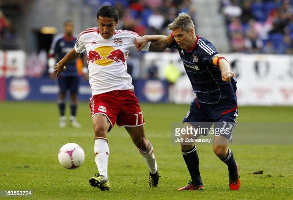 Tim Cahill of New York Red Bulls and Logan Pause of Chicago Fire fight for the ball during their match at Red Bull Arena on October 6 2012 in...
