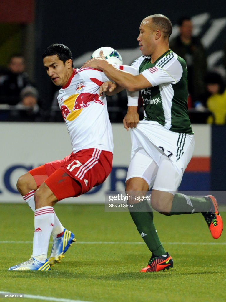 <a gi-track='captionPersonalityLinkClicked' href=/galleries/search?phrase=Tim+Cahill+-+Soccer+Player&family=editorial&specificpeople=209085 ng-click='$event.stopPropagation()'>Tim Cahill</a> #17 of New York Red Bulls and <a gi-track='captionPersonalityLinkClicked' href=/galleries/search?phrase=Mikael+Silvestre&family=editorial&specificpeople=202516 ng-click='$event.stopPropagation()'>Mikael Silvestre</a> #27 of the Portland Timbers battle for a ball during the second half of the game at Jeld-Wen Field on March 03, 2013 in Portland, Oregon. The game ended in a 3-3 draw.