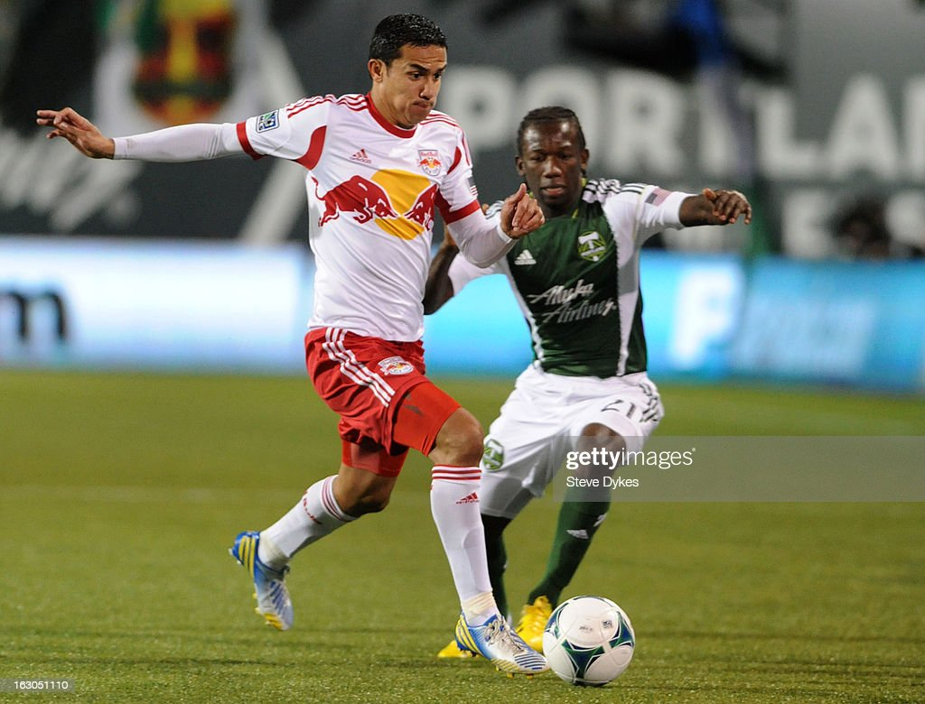 <a gi-track='captionPersonalityLinkClicked' href=/galleries/search?phrase=Tim+Cahill+-+Soccer+Player&family=editorial&specificpeople=209085 ng-click='$event.stopPropagation()'>Tim Cahill</a> #17 of New York Red Bulls brings the ball up the field as Diego Chara #21 of Portland Timbers defends during the second half of the game at Jeld-Wen Field on March 03, 2013 in Portland, Oregon. The game ended in a 3-3 draw.