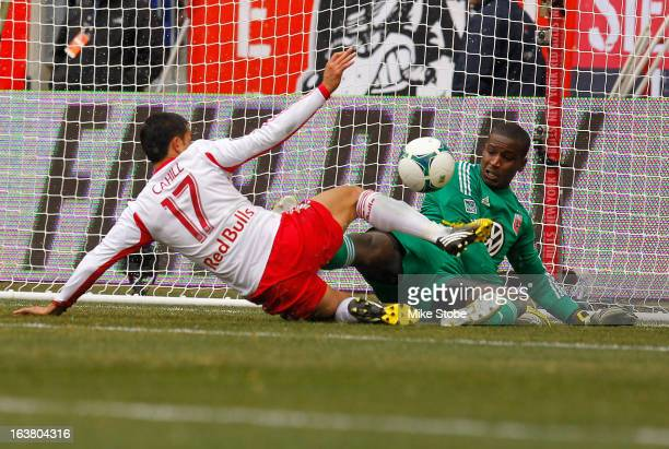 Tim Cahill of New York Red Bulls is denied by Bill Hamid of DC United at Red Bull Arena on March 16 2013 in Harrison New Jersey Red Bulls and DC...