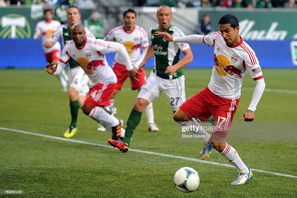 <a gi-track='captionPersonalityLinkClicked' href=/galleries/search?phrase=Tim+Cahill+-+Soccer+Player&family=editorial&specificpeople=209085 ng-click='$event.stopPropagation()'>Tim Cahill</a> #17 of New York Red Bulls puts a shot on goal during the first half of the game against the Portland Timbers at Jeld-Wen Field on March 03, 2013 in Portland, Oregon.