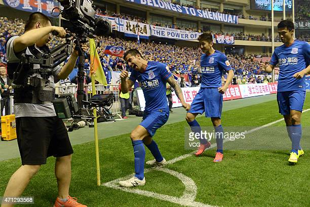 Tim Cahill of Shanghai Greenland Shenhua celebrates a goal during the Chinese Football Association Super League between Shanghai Greenland Shenhua...