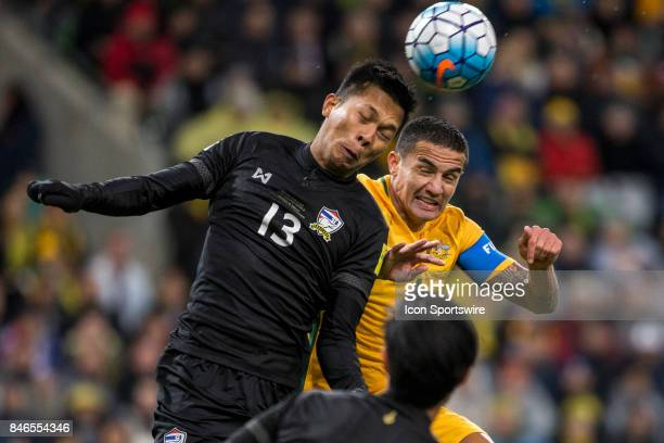 Tim Cahill of the Australian National Football Team and Pansa Hemviboon of the Thailand National Football Team contest the ball during the FIFA World...