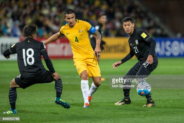 Tim Cahill of the Australian National Football Team passes the ball in front of Chanathip Songkrasin of the Thailand National Football Team and...