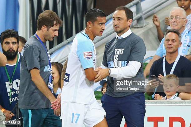 Tim Cahill of the City comes with encouragement from City head coach Michael Valkanis during the round 23 ALeague match between Melbourne City FC and...
