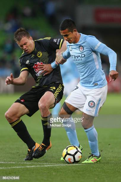 Tim Cahill of the City controls the ball from Daniel Mullen of Wellington Phoenix during the round three ALeague match between Melbourne City and the...