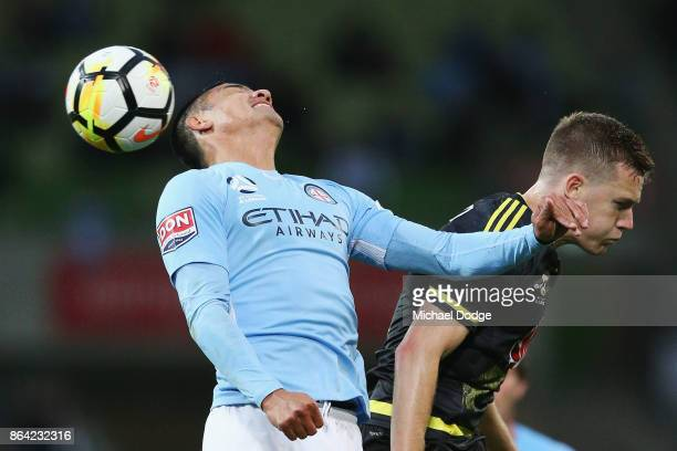 Tim Cahill of the City heads the ball against Scott Galloway of Wellington Phoenix during the round three ALeague match between Melbourne City and...