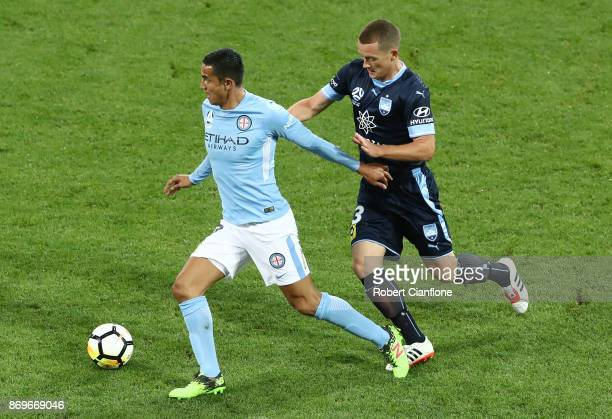 Tim Cahill of the City is chased by Brandon O'Neill of Sydney FC during the round five ALeague match between Melbourne City FC and Sydney FC at AAMI...