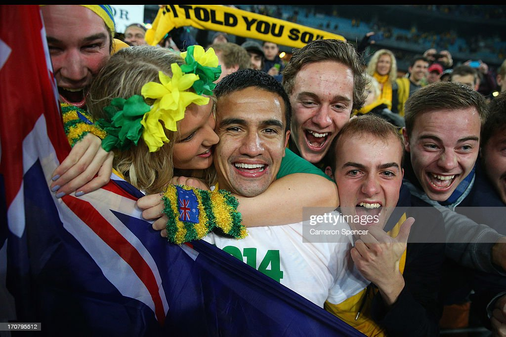 <a gi-track='captionPersonalityLinkClicked' href=/galleries/search?phrase=Tim+Cahill+-+Soccer+Player&family=editorial&specificpeople=209085 ng-click='$event.stopPropagation()'>Tim Cahill</a> of the Socceroos celebrates with fans after winning the FIFA 2014 World Cup Asian Qualifier match between the Australian Socceroos and Iraq at ANZ Stadium on June 18, 2013 in Sydney, Australia.
