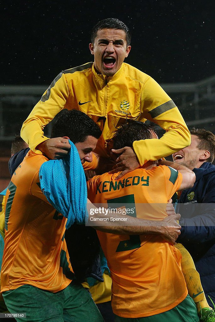 <a gi-track='captionPersonalityLinkClicked' href=/galleries/search?phrase=Tim+Cahill+-+Soccer+Player&family=editorial&specificpeople=209085 ng-click='$event.stopPropagation()'>Tim Cahill</a> of the Socceroos celebrates with team mate Josh Kennedy after Kennedy scored a goal during the FIFA 2014 World Cup Asian Qualifier match between the Australian Socceroos and Iraq at ANZ Stadium on June 18, 2013 in Sydney, Australia.