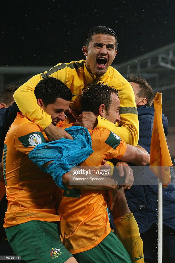 <a gi-track='captionPersonalityLinkClicked' href=/galleries/search?phrase=Tim+Cahill+-+Voetballer&family=editorial&specificpeople=209085 ng-click='$event.stopPropagation()'>Tim Cahill</a> of the Socceroos celebrates with team mate Josh Kennedy after Kennedy scored a goal during the FIFA 2014 World Cup Asian Qualifier match between the Australian Socceroos and Iraq at ANZ Stadium on June 18, 2013 in Sydney, Australia.