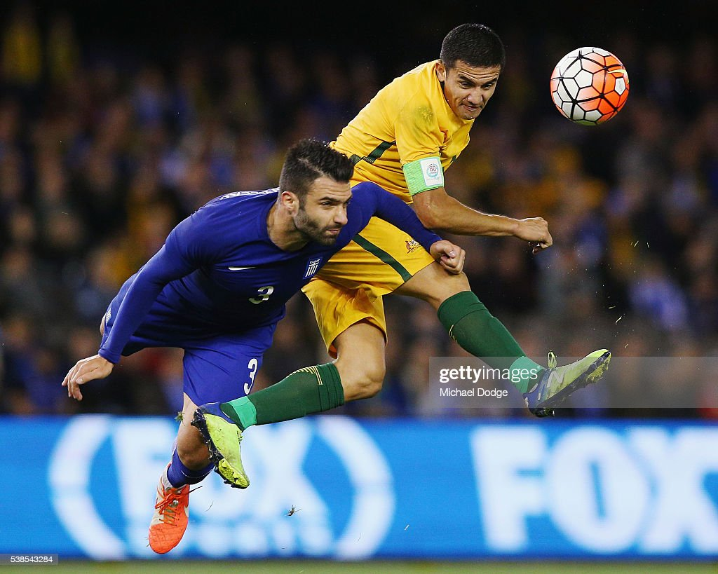 <a gi-track='captionPersonalityLinkClicked' href=/galleries/search?phrase=Tim+Cahill+-+Soccer+Player&family=editorial&specificpeople=209085 ng-click='$event.stopPropagation()'>Tim Cahill</a> of the Socceroos heads the ball against Giorgios Tzavellas of Greece (L) during the International Friendly match between the Australian Socceroos and Greece at Etihad Stadium on June 7, 2016 in Melbourne, Australia.