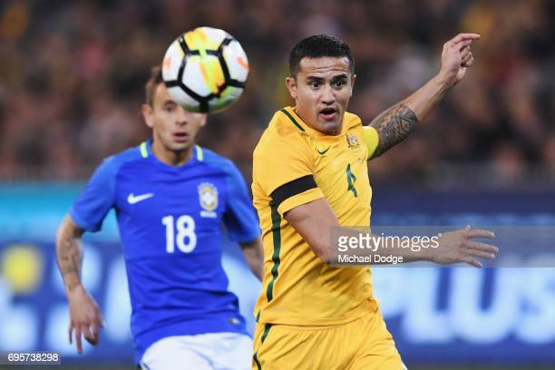 Tim Cahill of the Socceroos heads the ball during the Brasil Global Tour match between Australian Socceroos and Brazil at Melbourne Cricket Ground on...