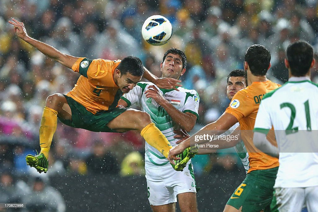 <a gi-track='captionPersonalityLinkClicked' href=/galleries/search?phrase=Tim+Cahill+-+Joueur+de+football&family=editorial&specificpeople=209085 ng-click='$event.stopPropagation()'>Tim Cahill</a> of the Socceroos heads the ball during the FIFA 2014 World Cup Asian Qualifier match between the Australian Socceroos and Iraq at ANZ Stadium on June 18, 2013 in Sydney, Australia.