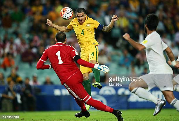 Tim Cahill of the Socceroos heads the ball for a goal during the 2018 FIFA World Cup Qualification match between the Australian Socceroos and Jordan...