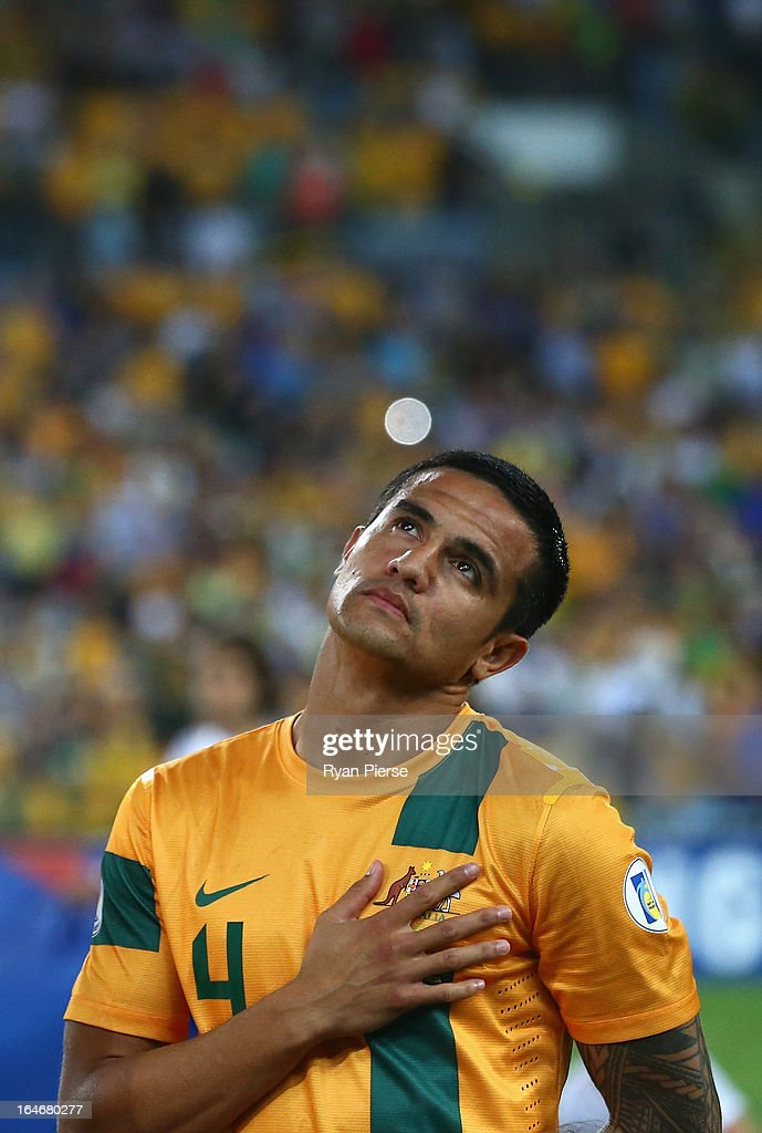 <a gi-track='captionPersonalityLinkClicked' href=/galleries/search?phrase=Tim+Cahill+-+Joueur+de+football&family=editorial&specificpeople=209085 ng-click='$event.stopPropagation()'>Tim Cahill</a> of the Socceroos looks on during the national anthem during the FIFA 2014 World Cup Qualifier match between the Australian Socceroos and Oman at ANZ Stadium on March 26, 2013 in Sydney, Australia.