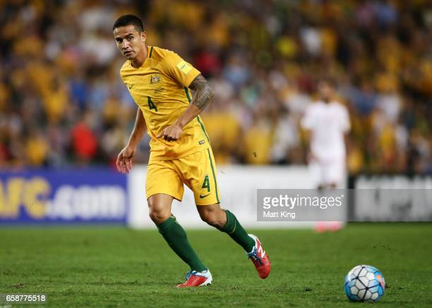 Tim Cahill of the Socceroos passes during the 2018 FIFA World Cup Qualifier match between the Australian Socceroos and United Arab Emirates at...