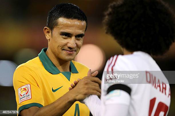 Tim Cahill of the Socceroos shakes hands with Omar Abdulrahman of United Arab Emirates during the Asian Cup Semi Final match between the Australian...