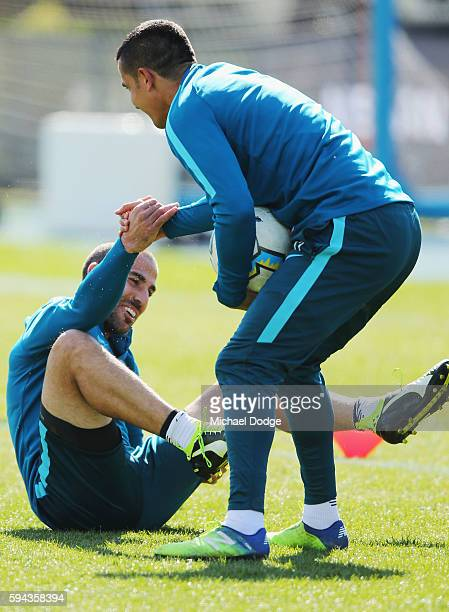 Tim Cahill picks up Manny Muscat after he competes for the ball during a Melbourne City FC ALeague training session ahead of their FFA Cup round of...
