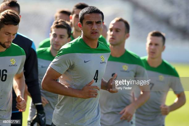 Tim Cahill runs with team mates during an Australian Socceroos training session at Central Coast Stadium on May 21 2014 in Gosford Australia 1