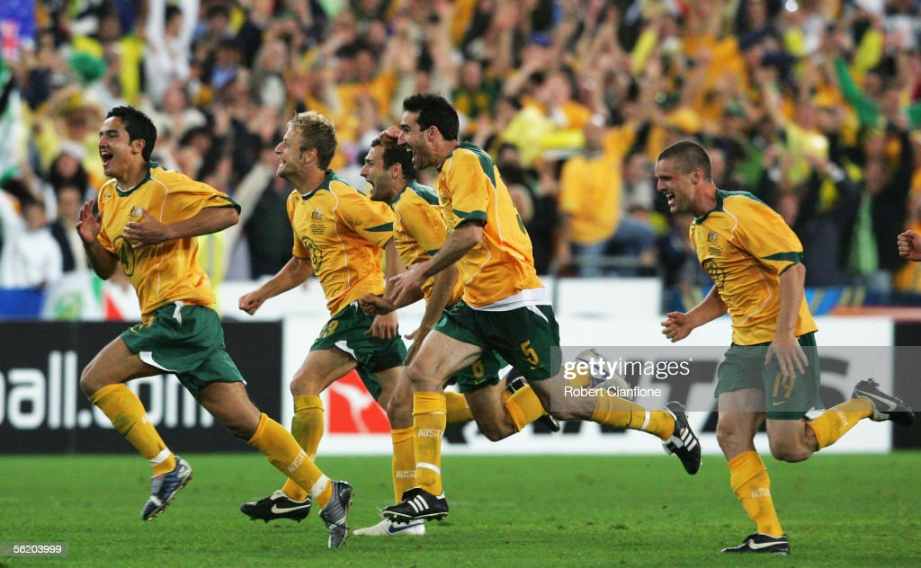 Tim Cahill #4, Scott Chipperfield #3, Tony Popovic #6, Tony Vidmar #5 and Jason Culina #19 of the Socceroos celebrates after winning the second leg of the 2006 FIFA World Cup qualifying match between Australia and Uruguay at Telstra Stadium November 16, 2005 in Sydney, Australia.