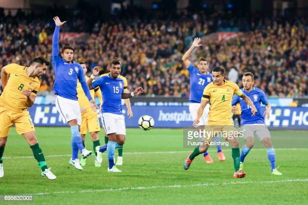 Tim Cahill shoots for goal during play as Brazil plays Australia in the Chevrolet Brasil Global Tour 2017 on June 13 2017 in Melbourne Australia...