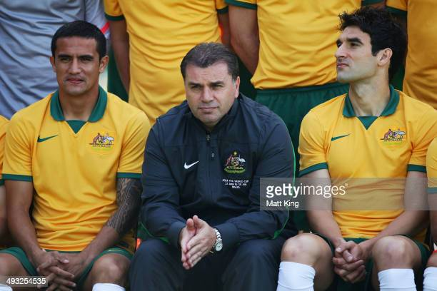 Tim Cahill Socceroos Head Coach Ange Postecoglou and Socceroos captain Mike Jedinak line up for the team photo during an Australian Socceroos...