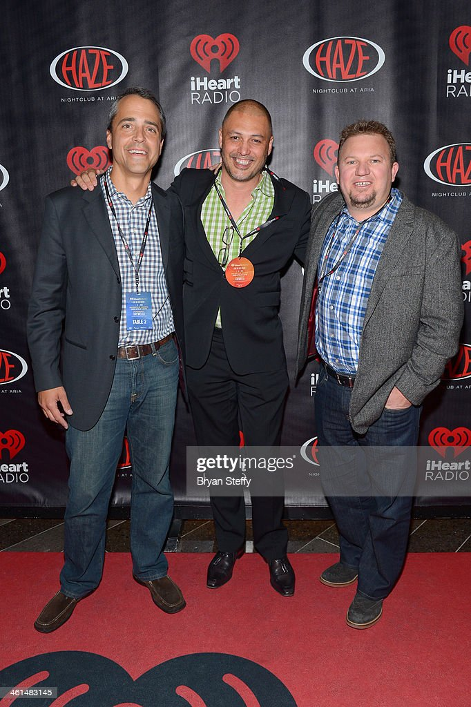 Tim Castelli, Executive Vice President of Digital Sales, Clear Channel Media and Entertainment (L) attends a private party celebrating CES 2014 hosted by iHeartRadio featuring a live performance by Krewella at Haze Nightclub at the Aria Resort & Casino at CityCenter on January 8, 2014 in Las Vegas, Nevada.