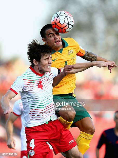 Tim Chahill of Australia competes for the ball wirh Eraj Rajabov of Tajikistan during the 2018 FIFA World Cup Qualifier match between the Australian...