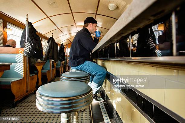 Tim Chalmers of Portland takes a sip of his coffee while eating breakfast at the Miss Portland Diner in Portland on Monday March 23