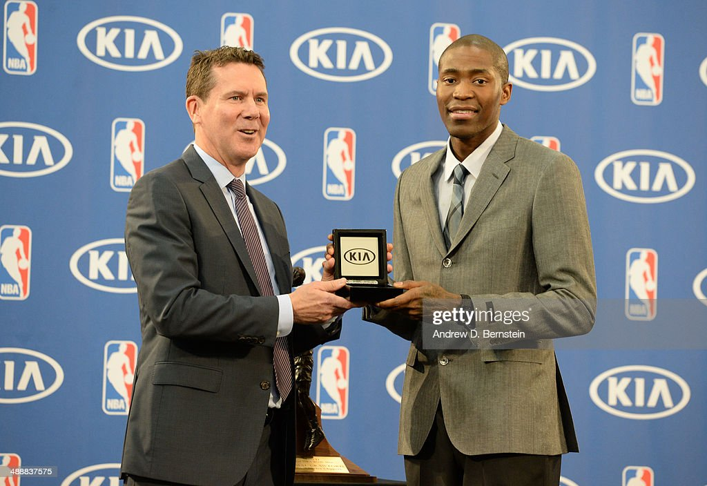 Tim Chaney of Kia Motors presents Jamal Crawford #11 of the Los Angeles Clippers with keys to a 2015 Kia Sorento to be donated to the charity of his choice during the Sixth Man Award Press Conference at the Los Angeles Clippers Training Facility on May 8, 2014 in Playa Vista, California.