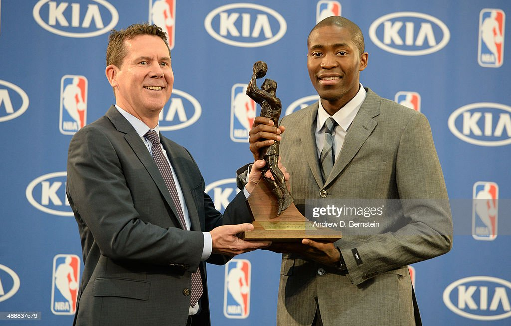 Tim Chaney of Kia Motors presents Jamal Crawford #11 of the Los Angeles Clippers with the Sixth Man Award during a press conference at the Los Angeles Clippers Training Facility on May 8, 2014 in Playa Vista, California.