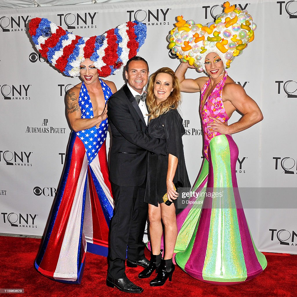 Tim Chappel (2nd L) and Lizzy Gardiner (2nd R) attend the 65th Annual Tony Awards at the Beacon Theatre on June 12, 2011 in New York City.