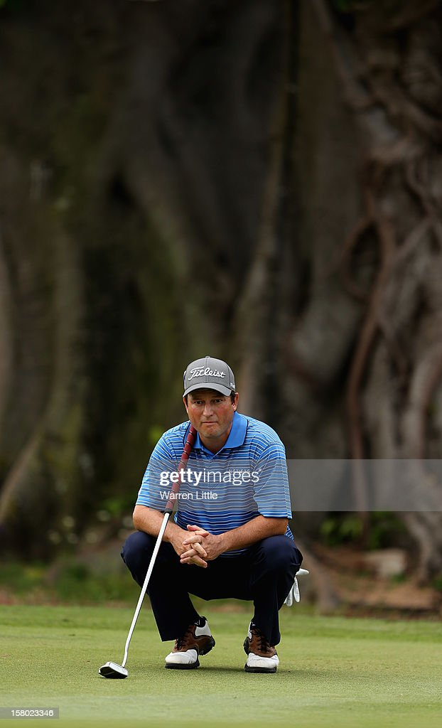Tim Clark of South Africa lines up a putt on the ninth green during the second round of The Nelson Mandela Championship presented by ISPS Handa at Royal Durban Golf Club on December 9, 2012 in Durban, South Africa.