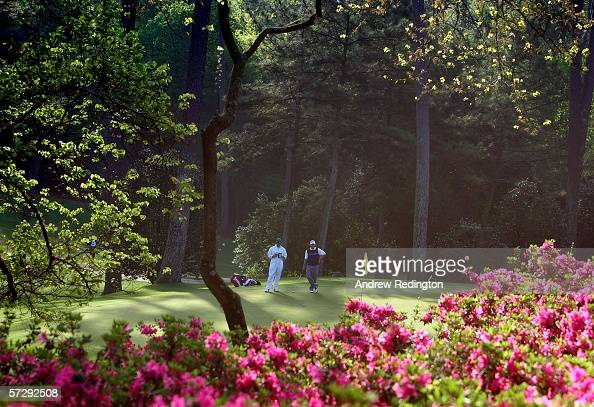 Tim Clark of South Africa lines up a putt on the tenth green during the continuation of the rain delayed third round of The Masters at the Augusta...