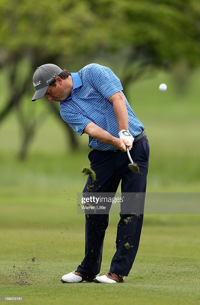 Tim Clark of South Africa plays his second shot into the eighth green during the second round of The Nelson Mandela Championship presented by ISPS Handa at Royal Durban Golf Club on December 9, 2012 in Durban, South Africa.