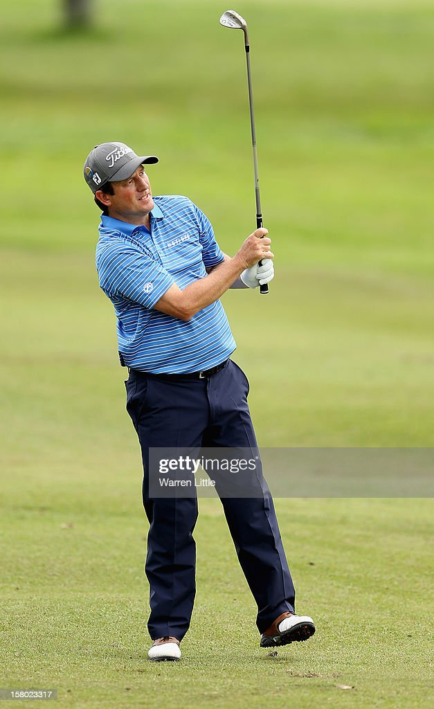 Tim Clark of South Africa reacts to his second shot nto the eighth green during the second round of The Nelson Mandela Championship presented by ISPS Handa at Royal Durban Golf Club on December 9, 2012 in Durban, South Africa.