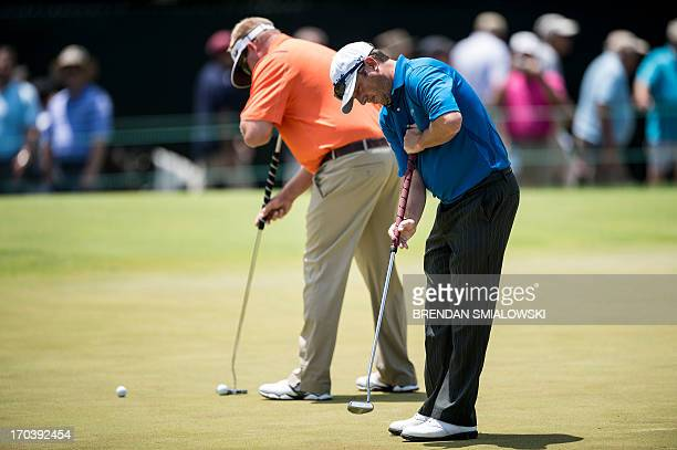 Tim Clark of South Africa uses an anchored putter during practice before the US Open at Merion Golf Club on June 12 2013 in Ardmore Pennsylvania AFP...