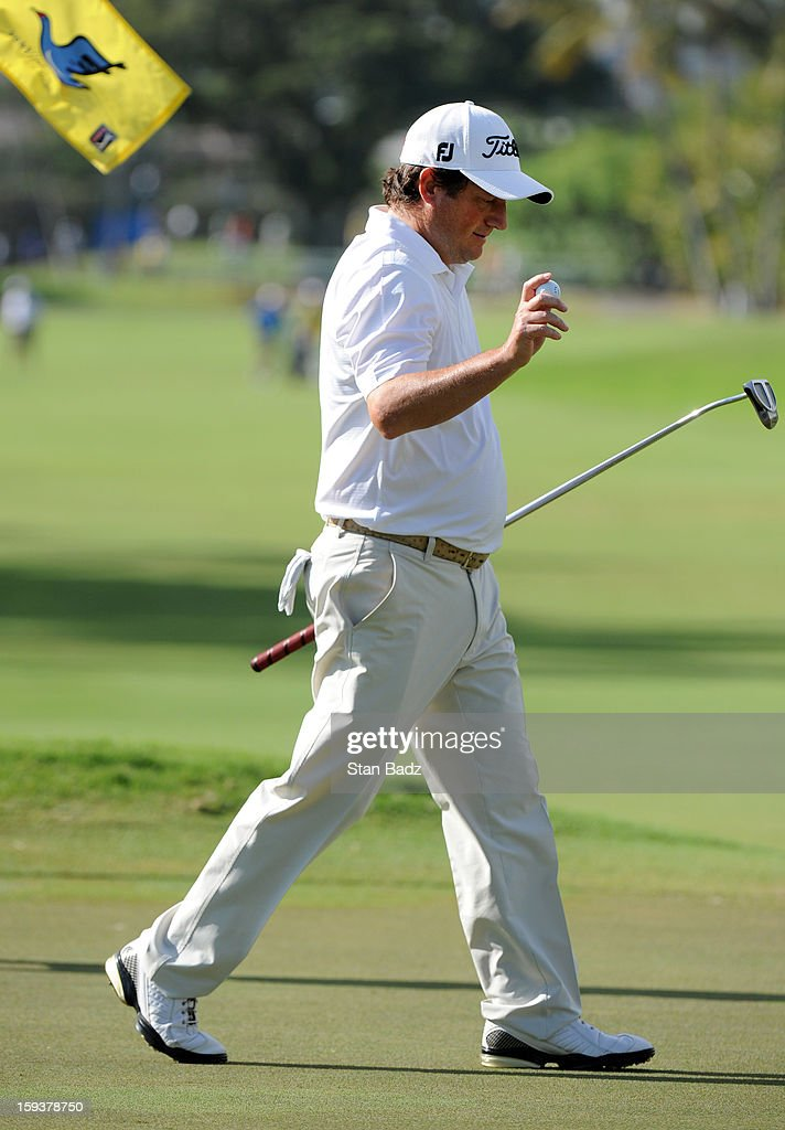 <a gi-track='captionPersonalityLinkClicked' href=/galleries/search?phrase=Tim+Clark+-+Golfer&family=editorial&specificpeople=13430522 ng-click='$event.stopPropagation()'>Tim Clark</a> of South Africa waves his golf ball as he exits the ninth green during the third round of the Sony Open in Hawaii at Waialae Country Club on January 12, 2013 in Honolulu, Hawaii.