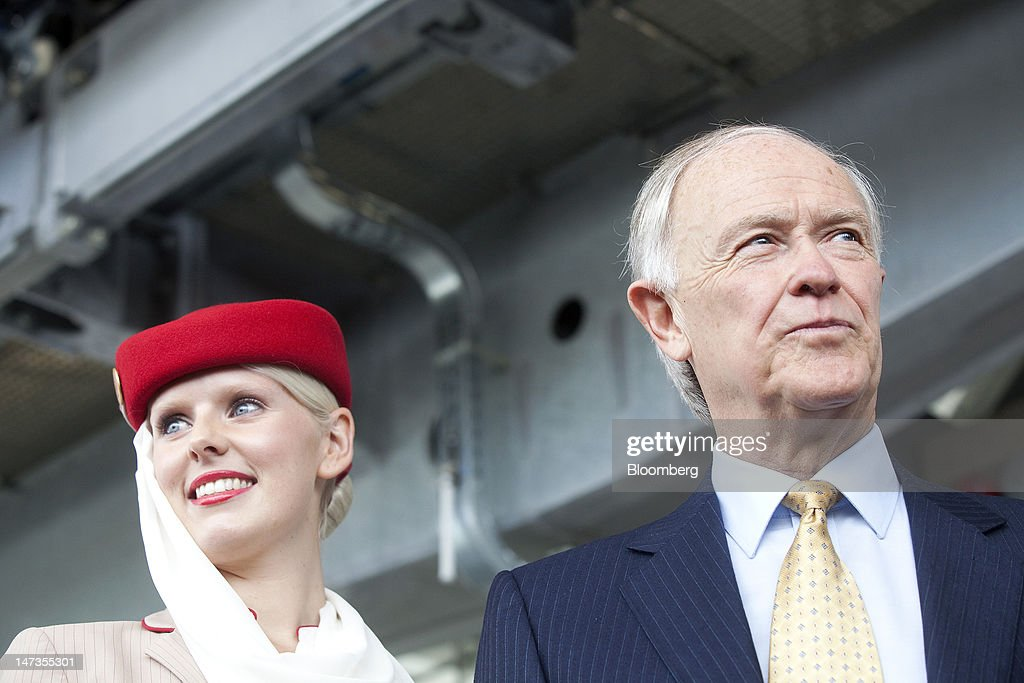 Tim Clark, president of Emirates, right, stands with an Emirates air hostess during the opening of a new cable car crossing above the River Thames in London, U.K., on Thursday, June 28, 2012. The cable car system, operated by Emirates, will run between Greenwich Peninsula and the Royal Victoria Docks. Photographer: Simon Dawson/Bloomberg via Getty Images