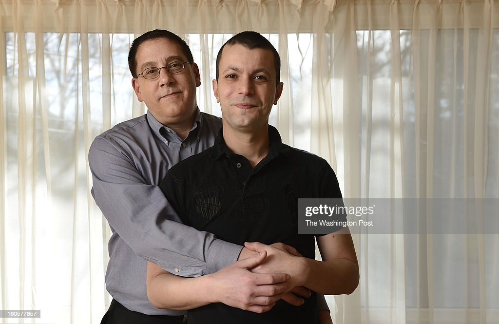 Tim Coco (left) and his husband Genesio Oliveira pose for a photo at their home in Haverhill, Mass., Saturday, Feb. 2, 2013. Current immigration laws do not allow spouses in same-sex marriages obtain visas. Oliveira is from Brazil. Gretchen Ertl for The Washington Post via Getty Images