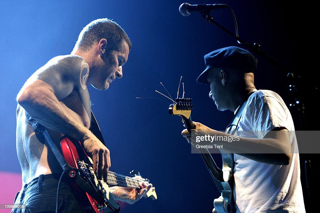 Tim Commerford and Tom Morello of Rage Against The Machine perform live at Gelredome on June 9, 2010 in Arnhem, Netherlands.