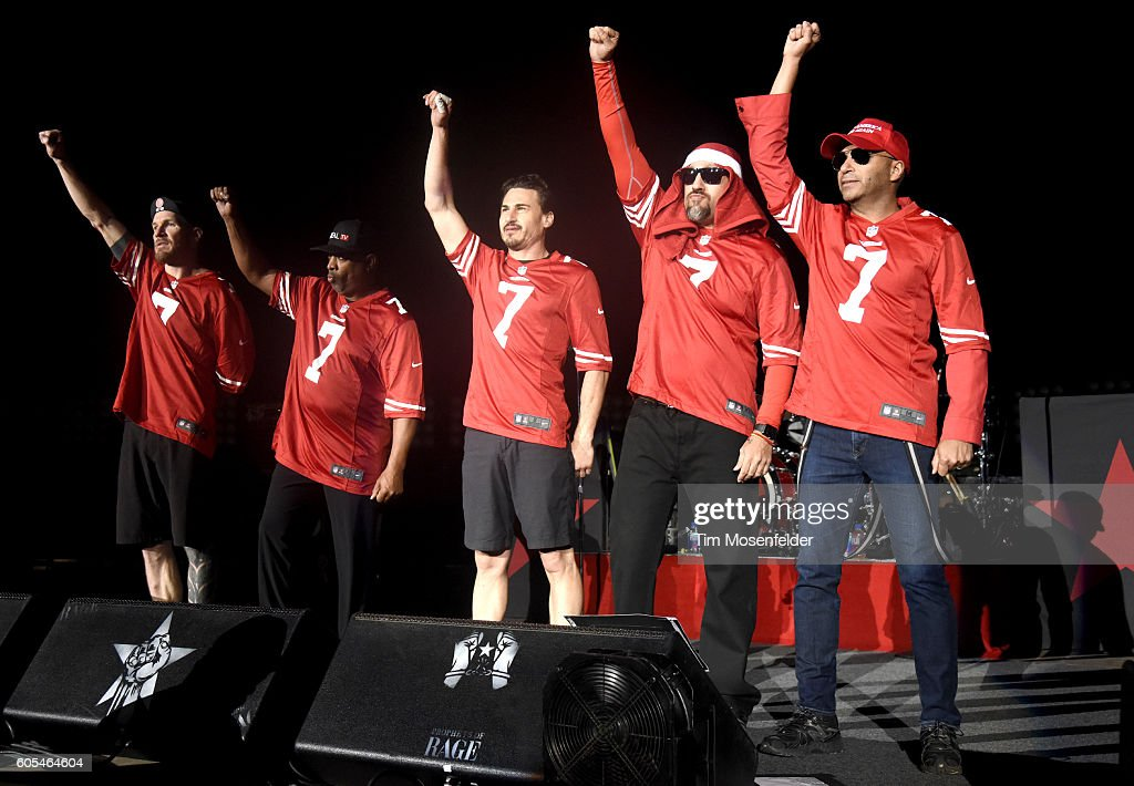 Tim Commerford, Chuck D, Brad Wilk, B Real, and Tom Morello of Prophets of Rage take a stand on violence at Shoreline Amphitheatre on September 14, 2016 in Mountain View, California.