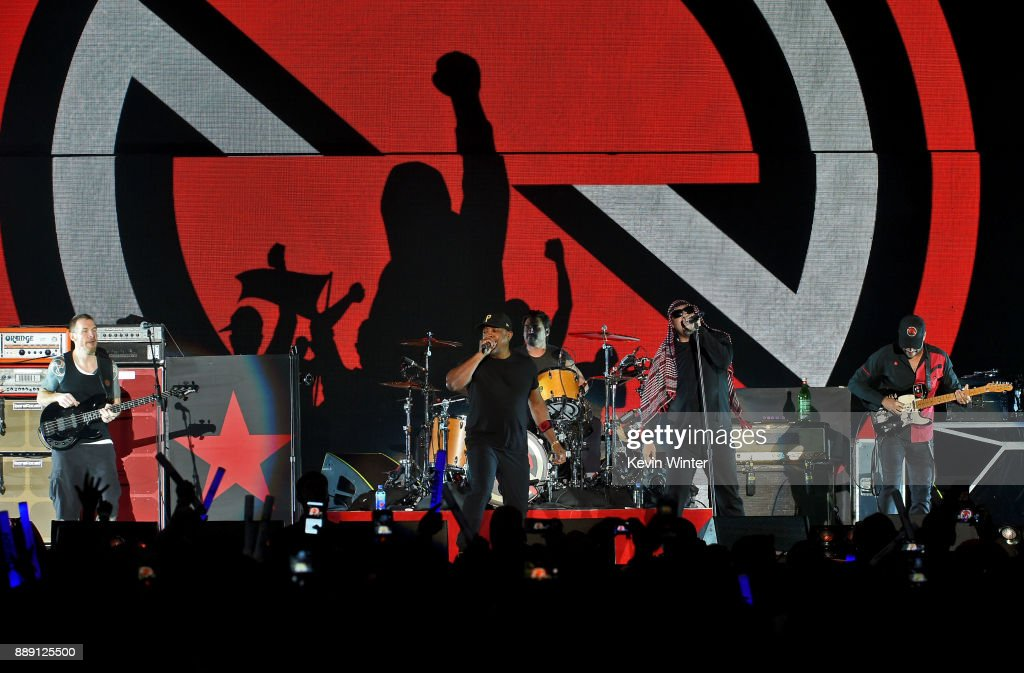 Tim Commerford, Chuck D, B-Real, Brad Wilk, B-Real and Tom Morello of Prophets of Rage perform onstage during KROQ Almost Acoustic Christmas 2017 at The Forum on December 9, 2017 in Inglewood, California.