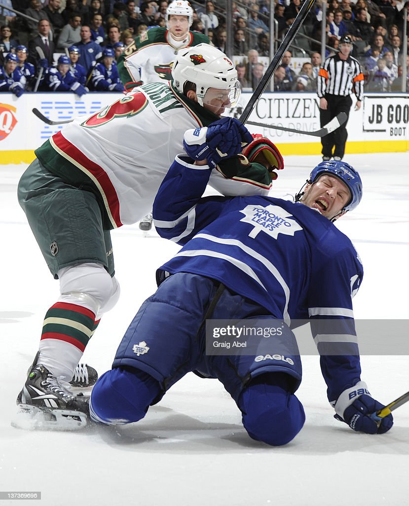 <a gi-track='captionPersonalityLinkClicked' href=/galleries/search?phrase=Tim+Connolly&family=editorial&specificpeople=208158 ng-click='$event.stopPropagation()'>Tim Connolly</a> #12 of the Toronto Maple Leafs is checked to the ice by <a gi-track='captionPersonalityLinkClicked' href=/galleries/search?phrase=Marek+Zidlicky&family=editorial&specificpeople=203291 ng-click='$event.stopPropagation()'>Marek Zidlicky</a> #3 of the Minnesota Wild during NHL game action January 19, 2012 at Air Canada Centre in Toronto, Ontario, Canada.