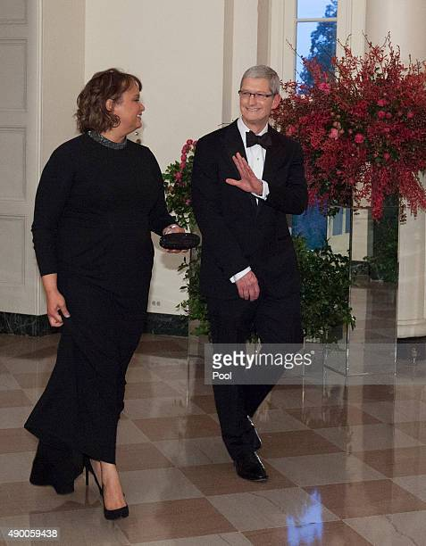Tim Cook CEO Apple and Ms Lisa Jackson arrive at the State Dinner for China's President President Xi and Madame Peng Liyuan at the White House for an...