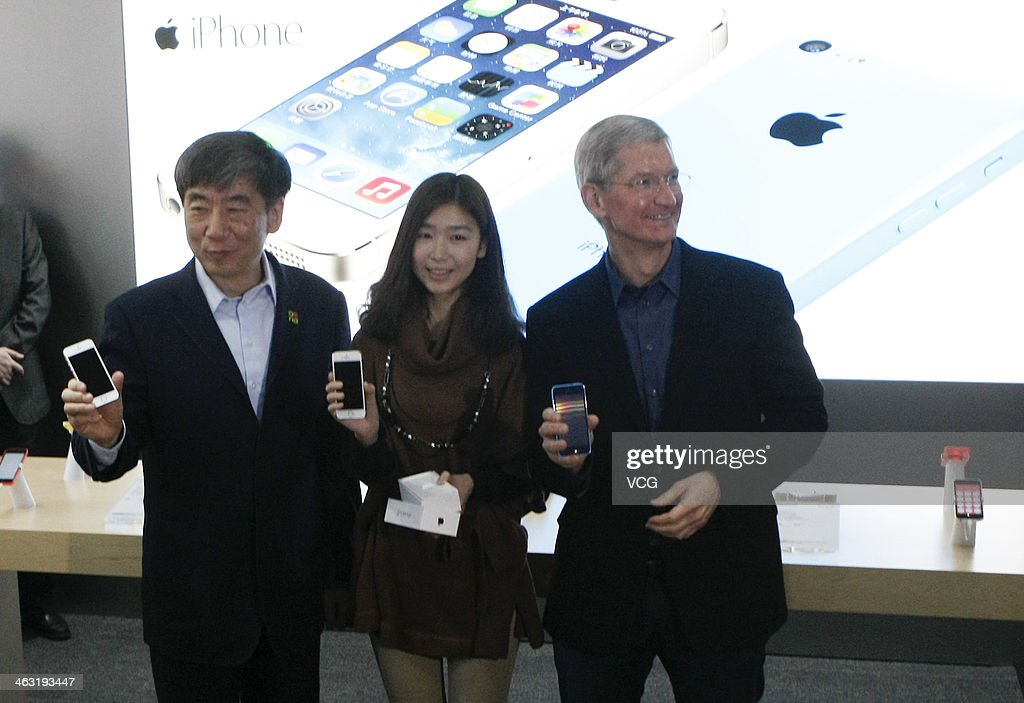 Tim Cook, Chief Executive Officer of Apple Inc., and China Mobile Chairman Xi Guohua (L) visit a China Mobile shop to celebrate the launch of iPhone 5S and iPhone 5C on China Mobile's fourth generation (4G) network on January 17, 2014 in Beijing, China. Apple Inc. and China Mobile Limited, the world's largest carrier with over 760 million subscribers, signed a deal on December 23, 2013 after six years of negotiations.