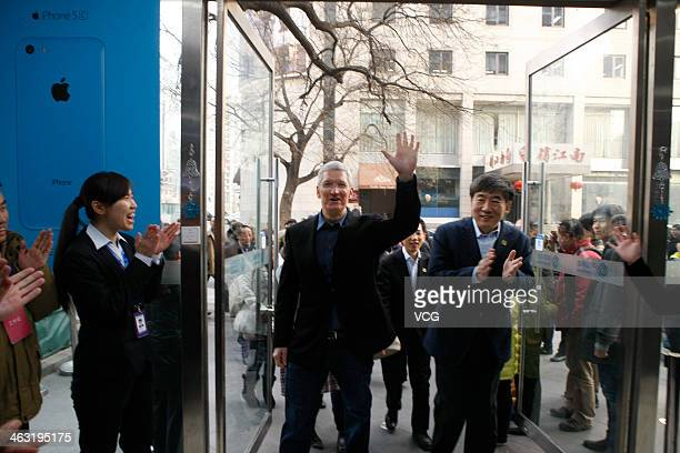 Tim Cook Chief Executive Officer of Apple Inc and China Mobile Chairman Xi Guohua visit a China Mobile shop to celebrate the launch of iPhone 5S and...